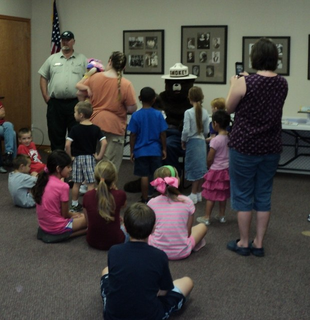Smokey the Bear visits with kids on Certificate Day.